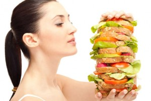 very hungry woman looking huge sandwich, isolated on background